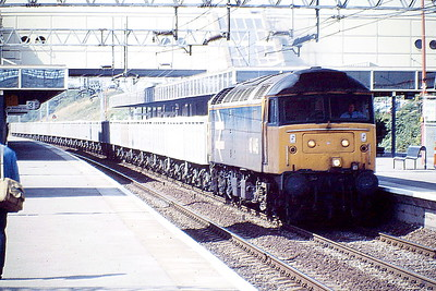 47445 heads south on a stone train through Milton Keynes, 15/08/88. The wagons look new, perhaps MEA's. 47445 was built by Crewe Works in 1964 as D1561 and was renumbered and ETHed in November 1973. It was withdrawn in July 1991 and scrapped in March 1994.