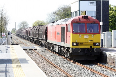 60062 STAINLESS PIONEER approaches Hubberts Bridge on the Bescot Yard - Boston Sleaford Sidings export steel, 26/04/21.