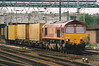 66008, now buckeye fitted, heads north through Doncaster on 6E98 Wembley - Wakefield, 28/04/01. 11/17 sold to GBRF, to become 66780