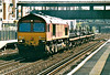 66006 heads north through Kensington Olympia on 6M78 Sheerness - Wembley Enterprise, 28/08/02.