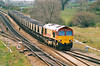 66010 heads for Immingham on an empty MGR rake at Brocklesby Junction, 18/04/00.