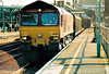 66001 paases through Ipswich Station on the Avonmouth - Felixstowe newsprint vans, 15/02/05.