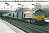 66007 passes through Northampton Station on 4G12 Wembley Yard - Hams Hall intermodal, 17/02/99.
