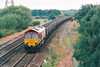 66011 approaches Eaglescliffe Station on a loaded MGR, 24/08/99.