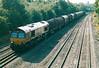 66003 passes Tupton on a northbound Wolverhampton Steel Terminal - Immingham steel empties train, 02/09/03.