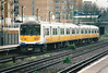 Class 319 008 pulls away from Kensington Olympia on a Rugby - Gatwick Airport service, 30/03/99.