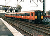 Class 318 268 departs Glasgow Central with a train for Ardrossan, 25/10/99.
