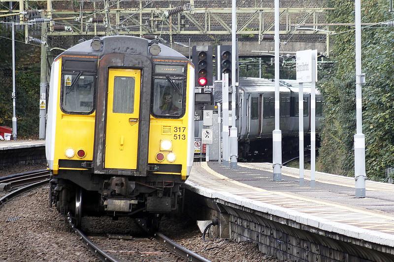 Class 317 513, c/w 317 501, arrives at Bishops Stortford on 2H33 1252 Cambridge North - Liverpool Street, 13/10/21.