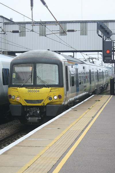 Class 365 504, c/w 365 514, draws into Peterborough Station from the Carriage Sidings to form 1P17 0917 to Kings Cross, 10/09/19.