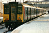 Class 317 319 sits on the rear end of a train to Kings Cross in Platform 3 at Peterborough, 31/12/96.