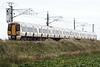 Class 387 103, c/w 387 115, head south past Ten Mile Bank on 1T41 1444 Kings Lynn - Kings Cross, 23/10/21.