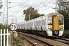 Class 387 104, c/w 387 102, passes Queen Adelaide (Kings Lynn) AHB on 1T41 1444 Kings Lynn - Kings Cross, 16/10/21.