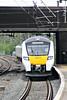 Class 700 127 draws into Huntingdon on 9J57 0946 Peterborough - Horsham, 24/04/18.