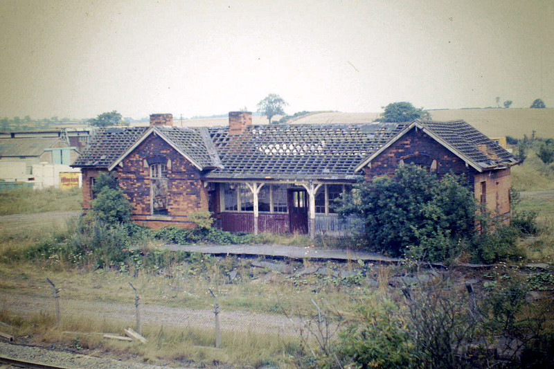 SAXBY - the sad remains of Saxby Station, 11/08/87. This was a very busy station in its day, being the junction for the M&GN to Bourne. This was the second alignment, the original lines passing behind this building, which was newly built for the opening of the M&GN. Although the building was on the M&GN side of the station, there were platforms on the Midland side too. The similarity between this building and that at Edmodthopre & Wymondham is obvious. A favourite spotting location in my youth. Every Tuesday, my Dad went to market at Melton Mowbray and, in school holidays, I cadged a lift. Getting dropped here was always a bit dodgy because, although you gained about an hour spotting time, depending on how drunk and unpredictable my Dad was, he sometimes forgot me and was not best pleased when my Mum made him come back for me!