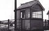 ATTLEBRIDGE - Third station north of Norwich City - the little signalbox at Attlebridge, unusual for the M&GN, seen here after closure.