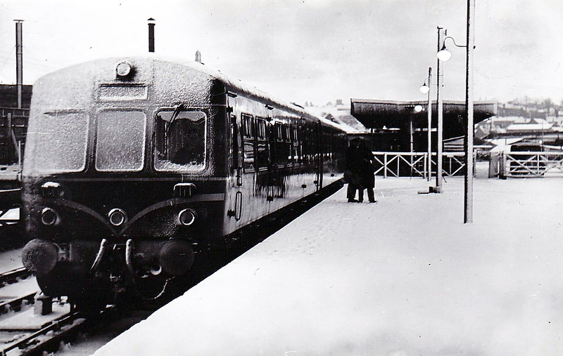 NORWICH CITY - A Class 101 DMU sits in a very snowy Norwich City Station with a train for Melton Constable. Despite it's grand frontage, the station was a poor neighbour to nearby Thorpe and was really only ever a branch line terminus.