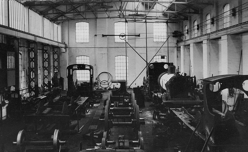MELTON CONSTABLE WORKS - A view inside the M&GN's Erecting Shops at Melton Constable. While it was certainly no Crewe, it provided employment in an area where there was little alternative to agriculture. Seen here are a clutch of Johnson 4-4-0's in various stages of undress, probably in the 1920's.