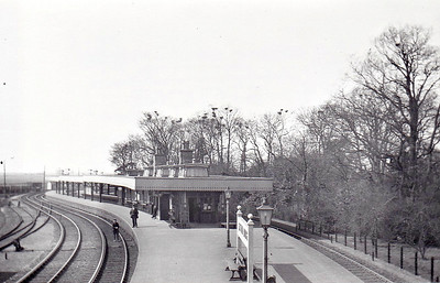 SUTTON BRIDGE - Opened in 1866 by the Lynn & Sutton Bridge Railway, Sutton Bridge, in common with many of the other larger M&GN stations, had a single island platform removed from the main station buildings, although this one did have the luxury of a bay platform at the western end. Just out of shot is Sutton Bridge Junction where the line from Wisbech North joined. Closed in February 1959, it managed to hang on to freight services until April 1965. The Sutton Bridge Bypass of the busy A17 road now completely occupies this site.