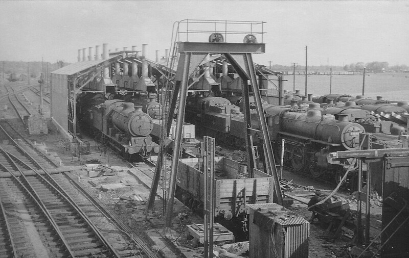 SOUTH LYNN - In the aftermath of the disastrous fire earlier in the year, here we see the locoshed being rebuilt on May 11th, 1958, only to be closed nine months later! The work was never actually completed by British Railways. A lot of Ivatt 4MT's present, 43090 on the right, and a solitary J17.