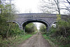 LITTLE BYTHAM - Bridge No.244, now firmly on M&GN territory, carried a farm track. It was if standard 3-arch construction, seen here on November 2nd, 2017. When I was a lad, this bridge formed part of my cycle route to Little Bytham to go spotting. There is no direct road between Edenham and Little Bytham and the journey was 7 miles. By going up Scottlethorpe Lane, onto the railway trackbed and then onto the park road, I cut an extremely hilly 3 miles off the journey, a major consideration when you've only got a clapped out bike about 3 sizes too small for you.