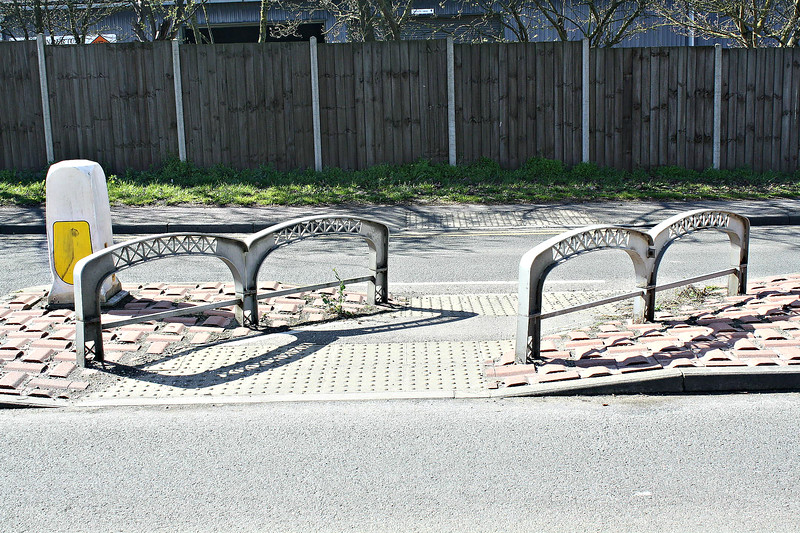 SUTTON BRIDGE, Lincolnshire (6) - In this small park area just by the Cross Keys Bridge, all of the furniture has been made to resemble the construction of the bridge - here we see barriers on a traffic island modelled on the girders that span the bridge - March 24th, 2014.
