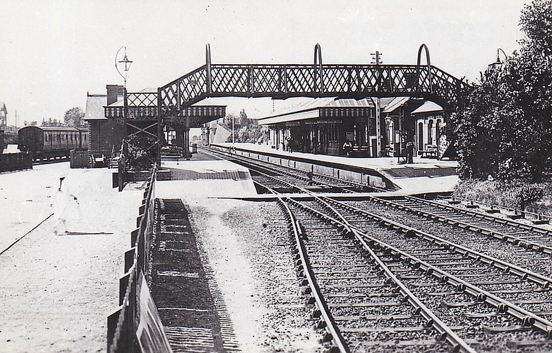 SHERINGHAM - Looking west after the 1906 alterations when the station was enlarged. A pretty little station then and still looking much like this today.