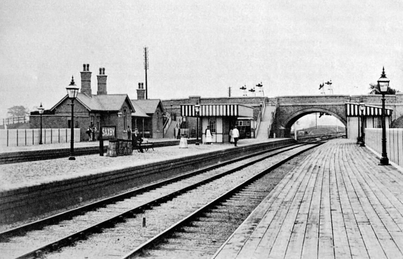 SAXBY - Seen here just completed, all new and shiny. It was of standard Midland Railway design, Midland tracks to the right, M&GN to the left. Just visible through bridge arch is the M&GN signalbox, the location of Milepost 0. The similarity to Edmondthorpe & Wymondham Station is obvious.