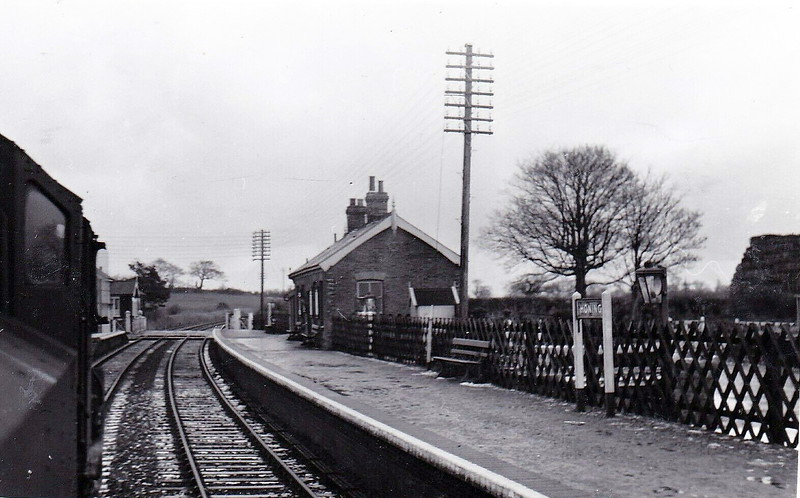HONING - Opened in August 1882 by the Yarmouth & North Norfolk Railway on the line from Melton Constable to Yarmouth Beach, Honing (for Worstead & Dilham), to give the official name, is typical of the small stations on this line. It closed in March 1959 but much of it remains including both platforms. Seen here from behind the tender of a 4MT.