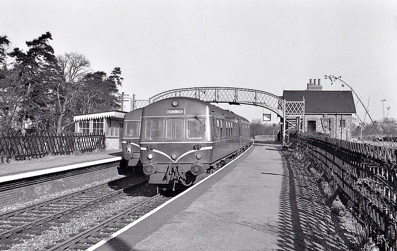 WHITWELL & REEPHAM - Opened in July 1882 by the Lynn & Fakenham Railway on its Melton Constable to Norwich City line, Whitwell and Reepham is seen on the last day of operations, 28/02/59, Class 101 DMU's crossing the platforms. The station is now the site of a railway museum.
