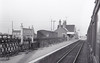 MURROW - Opened in August 1866 by the Peterborough, Wisbech and Sutton Bridge Railway, Murrow is seen here on the last day of operations in February 1959. Murrow had the distinction of having two stations, unconnected, on different lines and a flat crossing, a real rarity in Britain.