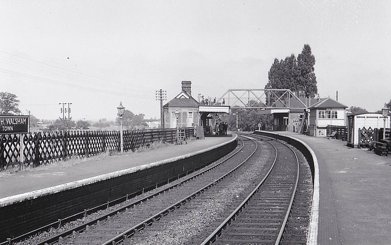 NORTH WALSHAM TOWN - Opened in June 1881 by the Yarmouth & North Norfolk Railway on the line from Yarmouth Beach to Melton Constable, it was also the terminus of the branch to Mundesley and Cromer. It closed in February 1959 but stayed open for freight until January 1966. Note the footbridge, a style typical to M&GN stations.