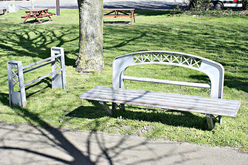 SUTTON BRIDGE, Lincolnshire (2) - In this small park area just by the Cross Keys Bridge, all of the furniture has been made to resemble the construction of the bridge - here we see a bench and cycle rack at the western end of the bridge - March 24th, 2014.