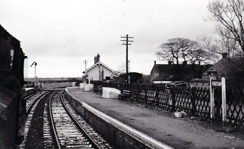MARTHAM - Located between Potter Heigham and Great Ormesby, the station opened in July 1878 and in November 1897 was renemd Martham (for Rollesby), although this does not appear on the station nameboard. It closed in March 1959. Seen here from behind a 4MT.