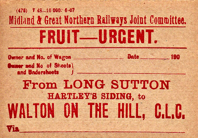 M&GN WAGON LABEL - Fruit from Hartley's Siding at Long Sutton to Walton on the Hill on the CLC system near Liverpool. Hartley's had a large jam factory here and so soft fruit would have been a regular traffic. Although only a single platform station, Long Sutton has a large goods yard and generated a lot of traffic. Note the print date of June 1907.