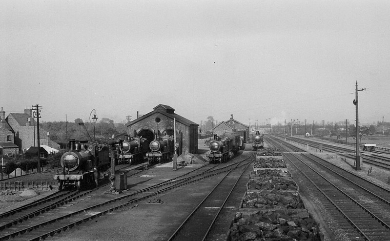 SPALDING LOCOSHED - The little two-road locoshed at Spalding usually played host to a fair number of engines due to the fact that all M&GN trains calling at the station were obliged to reverse - notice that all of the engines in this picture face south! Spalding was also the terminus of local services from Sutton Bridge and Bourne. Seen here in the 1920's I think.