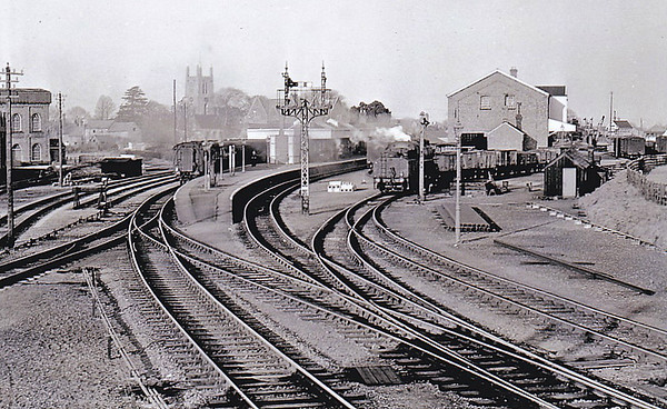 BOURNE - Looking across the station from the West Signalbox, fairly near to closure I think. An Ivatt Class 4MT 2-6-0 shunts in the goods yard, Red Hall and Abbey Church to its left and the East Signalbox just visible to the right. Note that the signal for the Essendine branch has been removed.