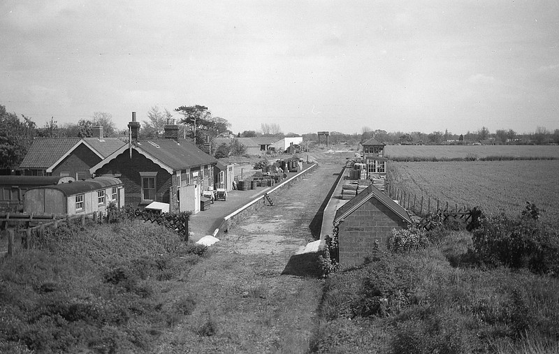 STALHAM - Opened by the Yarmouth & North Norfolk Railway in July 1880, Stalham was the second stop from North Walsham on the line to Yarmouth Beach. It closed along with everything else and in this picture appears to be in use as a builders yard. Most of the buildings appear to be fairly intact. The station building was eventually demolished and re-erected at Holt on the NNR.