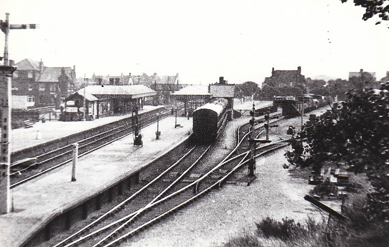SHERINGHAM - Looking east from the road bridge after 1906, when the station was remodelled and the original signalbox was replaced by one at each end of the station.