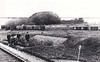 ATTLEBRIDGE - Third station north of Norwich City - what must be the entire station staff at work in the flower bed - not many trains to keep them busy! Note the LDECR wagon and what looks like a stable on the extreme left - horse for shunting? Note that the original print has been rather crudely cropped, I know not why.