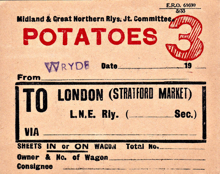 M&GN WAGON LABEL - WRYDE - Label for a seemingly regular flow of potatoes from Wryde to Stratford Market in East London - print date May 1933. Although Wryde had no population (there is no such place!), up to 4 freight trains were scheduled to pick up/drop off there every day right up until the line's closure in 1959.