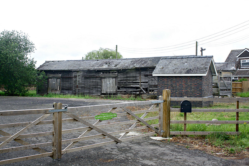 NORTH DROVE - What remains of North Drove Station. The station building and the platforms have disappeared but the wooden goods shed and the weighbridge hut remain. Seen here looking north on 29/06/17.
