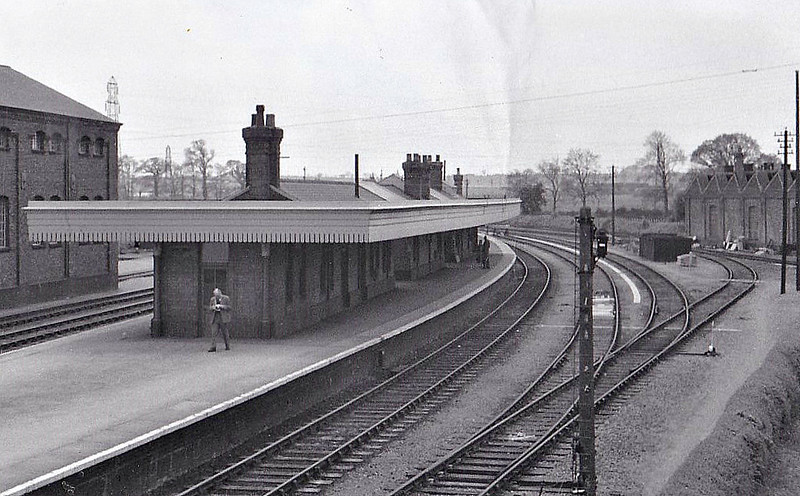 BOURNE - The M&GN was very fond of the island platform layout for major stations and Bourne was no exception. Seen here about 3 months after closure but still open for freight traffic, looking west, locoshed to the right, goods shed to the left.