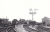 BOURNE - Looking east in the 1940's, locoshed and water tower on the left, goods shed on the right and GNR somersault signals in action.