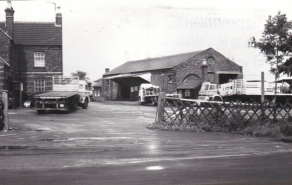 LONG SUTTON - The goods yard at Long Sutton was very extensive and, seasonally, very busy, the large goods storage shed being evidence of that. A view through the entrance gate with the station buildings to the left.