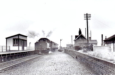 NORTH DROVE - Opened in August 1866 by the Spalding & Bourne Railway, North Drove Station really was in the middle of nowhere, the nearest, very small village being Pode Hole, about half a mile away. The station closed to all traffic in September 1958 and this shot a an Ivatt Class 4MT 2-6-0 on a Spalding train is probably from about that time. Note that the passing loop has already been removed.
