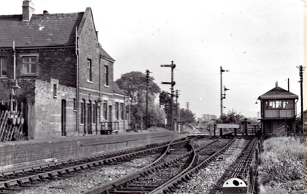 LONG SUTTON - looking east from halfway along the platform. Note the GN somersault signals on the east bound post and the later LNER upper quadrant signals on the west bound post. Note also automatic tablet exchange apparatus just to the left of the buffer.