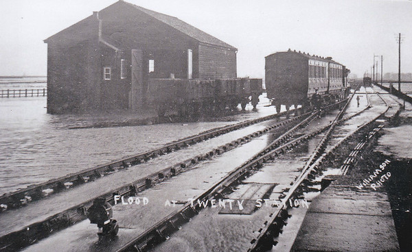 TWENTY - On December 3rd, 1911, winter storms caused flooding of the line between Bourne and Twenty. Special trains brought ballast from Holt to repair the undermined track and the line was re-opened on December 9th. It is evident from the picture, a view looking towards Spalding, that the flooding was quite widespread and fairly deep in places. I wonder if the train backing down is running a Twenty - Spalding shuttle service.