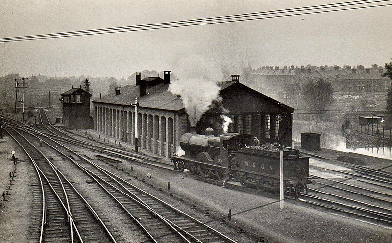 NORWICH CITY LOCOSHED - A large, three-road, single ended locoshed, built when the station was completed in 1882. It closed with closure of the system in February 1959. I think the loco is No.39 but I can't be certain.
