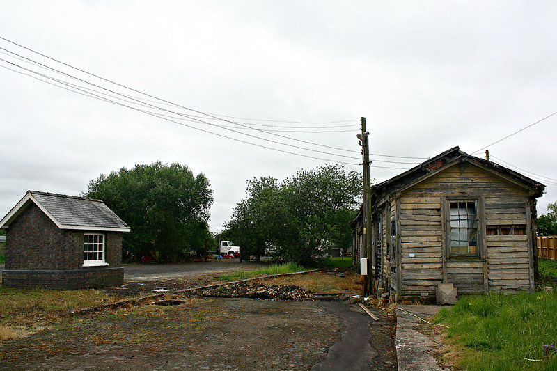 NORTH DROVE - What remains of North Drove Station. The goods shed and the weighbridge hut, looking west. Note the original edging stones for the loading docks and the telegraph pole is the same one as in the 1950's picture. Seen here on 29/06/17.