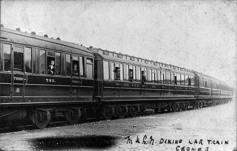 DINING CAR TRAIN, CROMER - GNR restaurant and dining stock at Cromer. The M&GN did not own any restaurant cars in its own right but the GNR provided them for a while around 1909 as part of a Manchester - Yarmouth through service, attached from Leeds, in the summer season only, and on the 1310 Kings Cross - Cromer train at about the same time, so I suspect that must be what these carriages are.